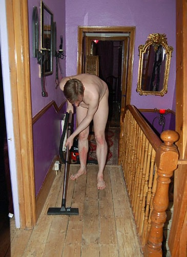 naked man vaccuuming