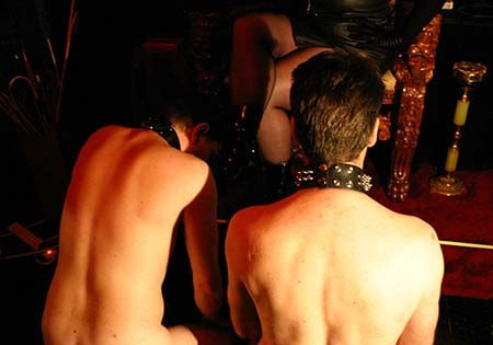 two naked slaves kneeling at my feet